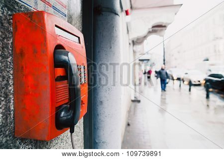 Red payphone on the wall