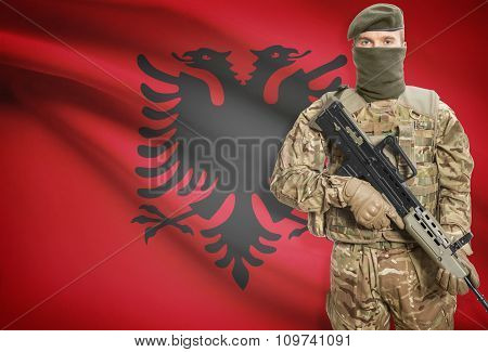 Soldier Holding Machine Gun With Flag On Background Series - Albania