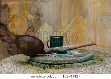 Old desert water well and drinking instruments