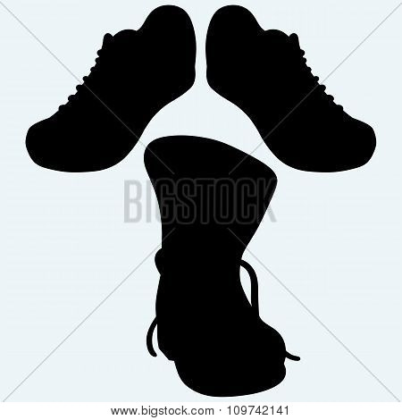 Old dirty boots and sneakers, sport shoes