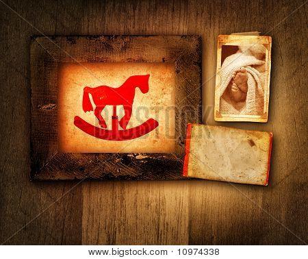 Grunge Rocking Horse And Baby Frame