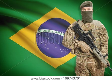 Soldier Holding Machine Gun With Flag On Background Series - Brazil