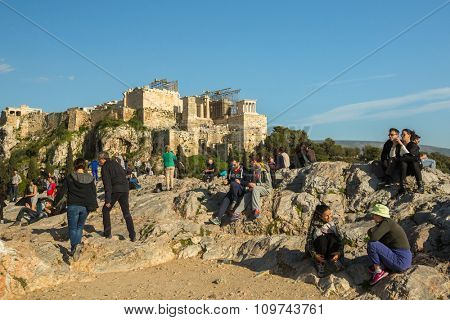 ATHENS, GREECE - CIRCA APR, 2015: Tourists in famous old city Acropolis. Construction began in 447 BC in the Athenian Empire. It was completed in 438 BC.