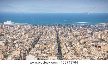 ATHENS, GREECE - CIRCA APR, 2015: Top View of the Aegean sea and streets labyrinth of Greek capital Athens.