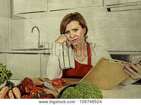 Cook Woman Bored And Frustrated Reading Recipes Book In Home Kitchen In Stress