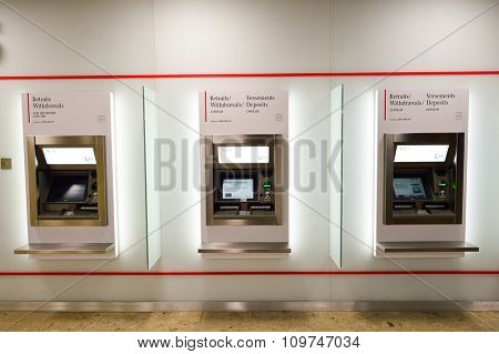 GENEVA, SWITZERLAND - NOVEMBER 19, 2015: UBS ATM in Geneva Airport. UBS AG is a Swiss global financial services company, incorporated in the Canton of Zurich