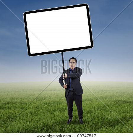 Businessperson Holds Billboard On The Field