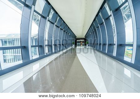 corridor with many glass windows in modern shopping mall