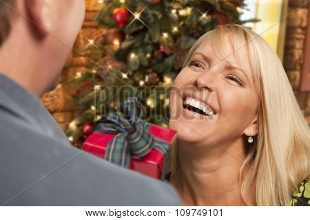 Attractive Girl Exchanging A Gift At A Christmas Party.