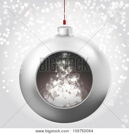 Christmas Ball with magic glow on the snowy background