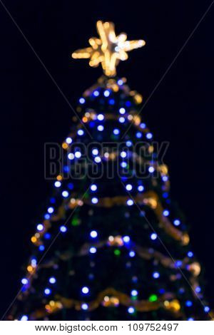 Blurred Christmas Tree With Colorful Lights