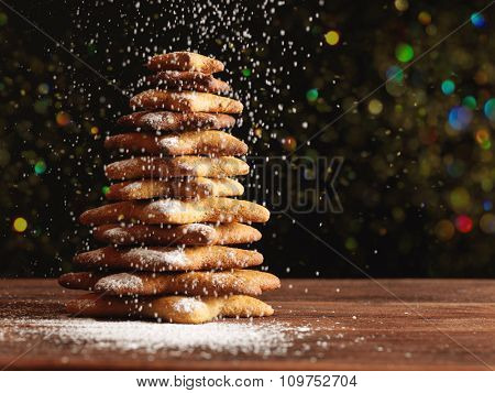 Baked gingerbread christmas tree on wooden background. Close-up
