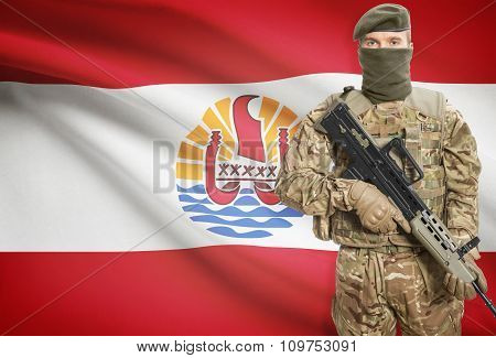 Soldier Holding Machine Gun With Flag On Background Series - French Polynesia