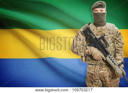Soldier Holding Machine Gun With Flag On Background Series - Gabon