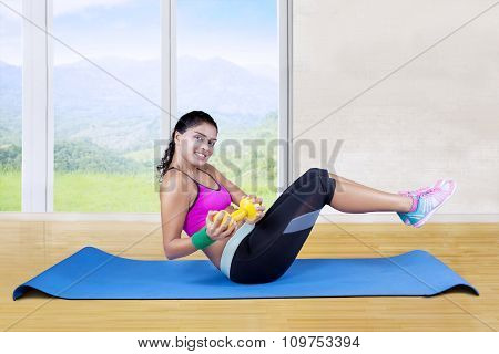 Woman Workout On Mattress With Dumbbell