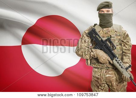 Soldier Holding Machine Gun With Flag On Background Series - Greenland