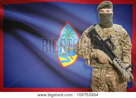 Soldier Holding Machine Gun With Flag On Background Series - Guam