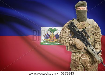 Soldier Holding Machine Gun With Flag On Background Series - Haiti