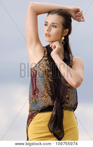 Portrait of beautiful young adult attractive sexy and sensuality pretty brunette woman posing on background blue sky. Outdoor shot