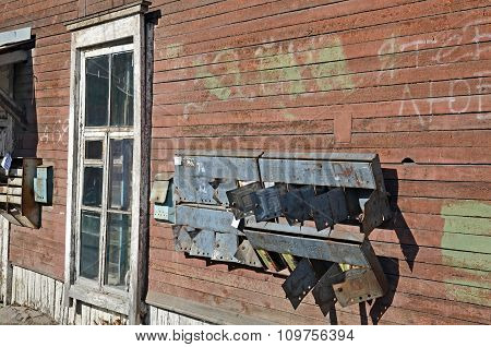 The Broken Rusty Mailboxes On The Wall Of Old Wooden House. Irkutsk Streets, Russia