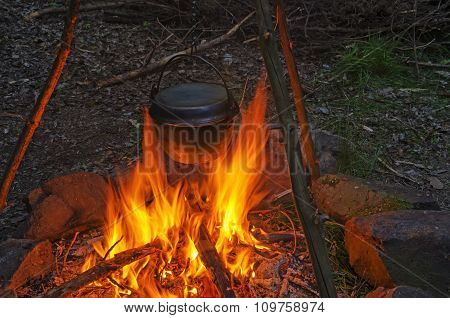 Cooking Dinner In Cauldron Pot Over An Open Fire