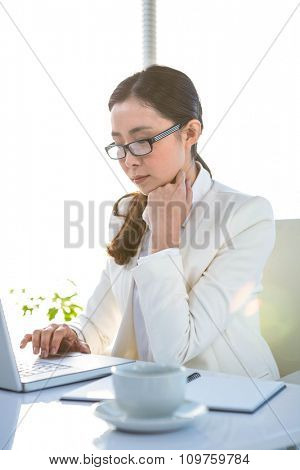 Businesswoman using her laptop pc at the desk in work