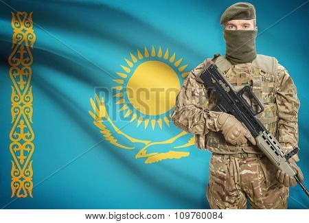 Soldier Holding Machine Gun With Flag On Background Series - Kazakhstan