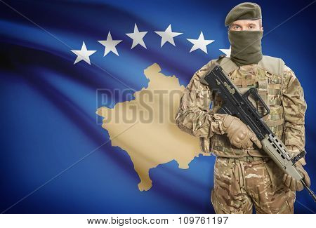 Soldier Holding Machine Gun With Flag On Background Series - Kosovo