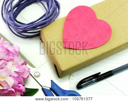 Beautiful Gifts With Flowers And Decorative Rope With Notebook