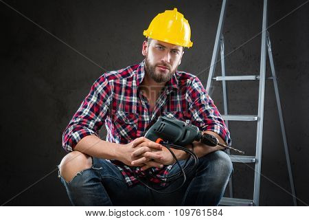 Attractive Young Workman With Drill