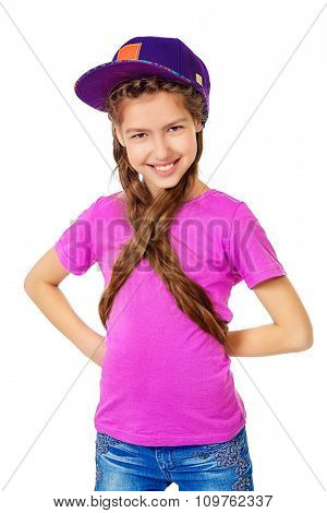 Joyful teen girl wearing casual clothes. Active lifestyle. Studio shot. Isolated over white.