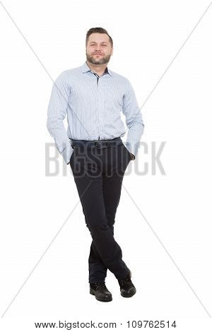 adult male with a beard. isolated on white background. legs crossed standing, hands in pockets. prot