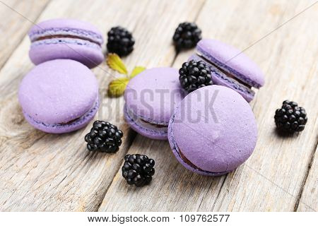Tasty Purple Macarons With Blackberry On Grey Wooden Background