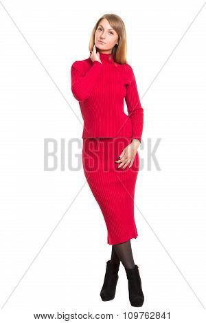 girl in a knitted woolen red suit. warm clothes. Isolated on white background