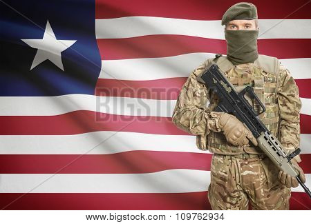 Soldier Holding Machine Gun With Flag On Background Series - Liberia