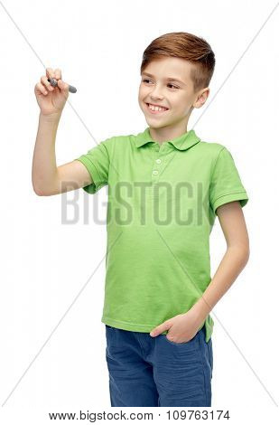 childhood, education, school and people concept - happy smiling boy in green polo t-shirt with marker writing something