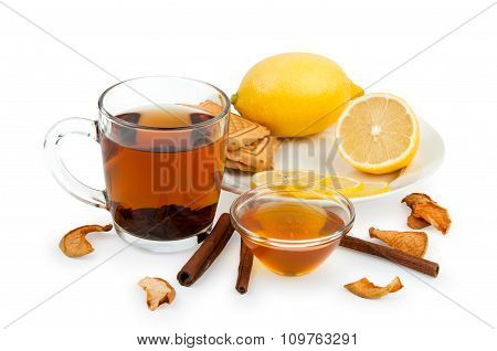 Tea, honey, lemon and cinnamon as cure for cold isolated on white background
