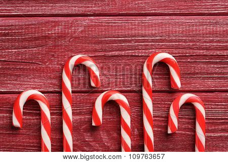 Christmas Candy Can On A Red Wooden Table
