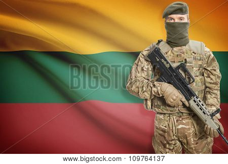 Soldier Holding Machine Gun With Flag On Background Series - Lithuania
