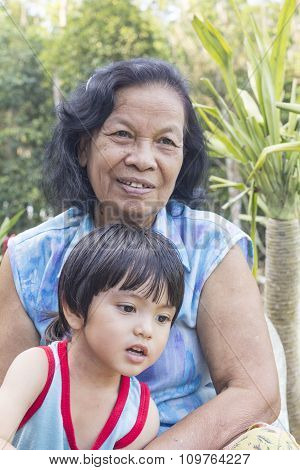 Senior Woman Together With Grandson