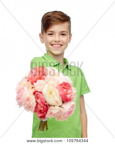 childhood, holidays and people concept - happy boy holding flower bunch