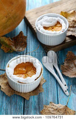 Tasty Pumpkin Pie In Bowl On A Blue Wooden Table