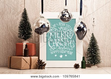 Christmas decorations with gifts and Christmas balls. Frame with congratulatory text