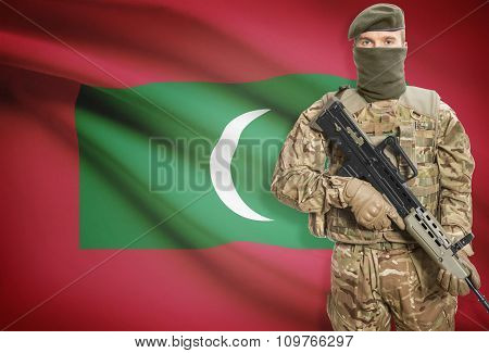 Soldier Holding Machine Gun With Flag On Background Series - Maldives