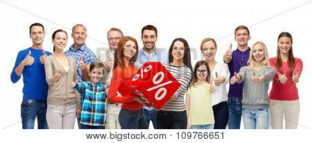 gesture, sale, shopping and people concept - group of smiling men women and kids showing thumbs up and holding red percentage sign