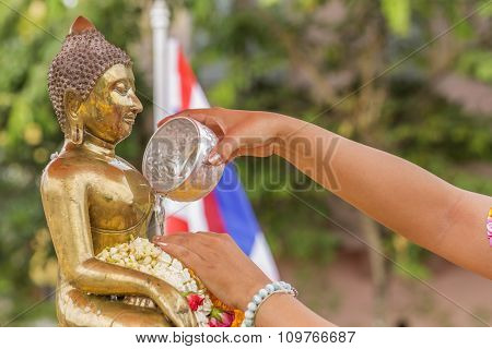 Water Pouring To Buddha Statue