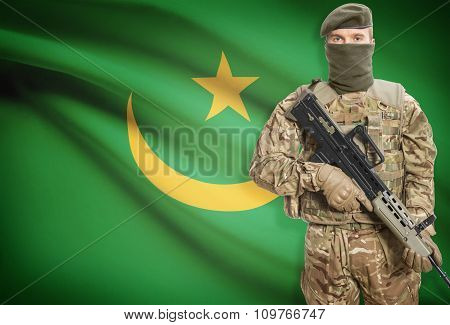 Soldier Holding Machine Gun With Flag On Background Series - Mauritania