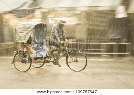 Tricycle taxi ride through the rain
