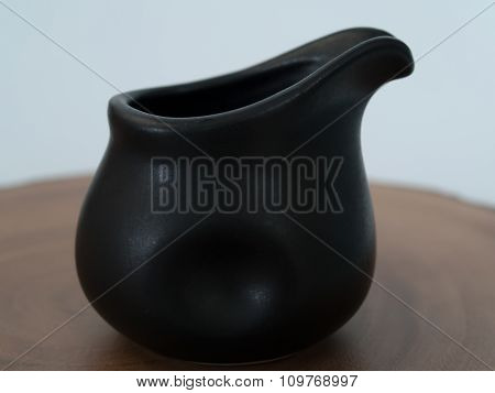 Glass Pitcher , Black  Placed On A Wooden Floor