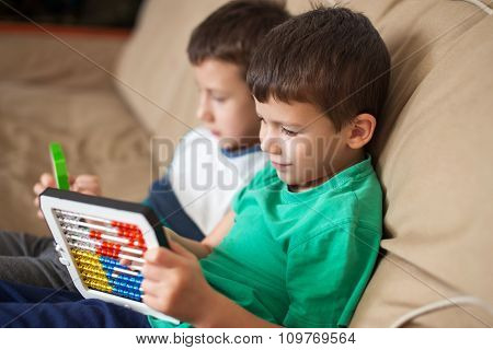 Little Boys Learn Counting On Abacus At Home
